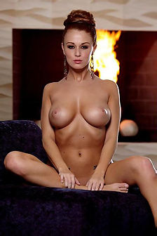Leanna Decker In Front Of The Fireplace